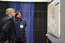 James Anderson discusses his research with an attendee during #NBB16.